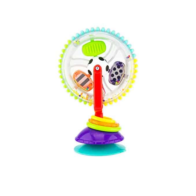 Sassy Wonder Activity Wheel. This fun toy connects to any flat surface by suction cup. Meaning it would be great to take to restaurants or outings to keep baby entertained, yet it's small enough to easily fit in a diaper bag.
